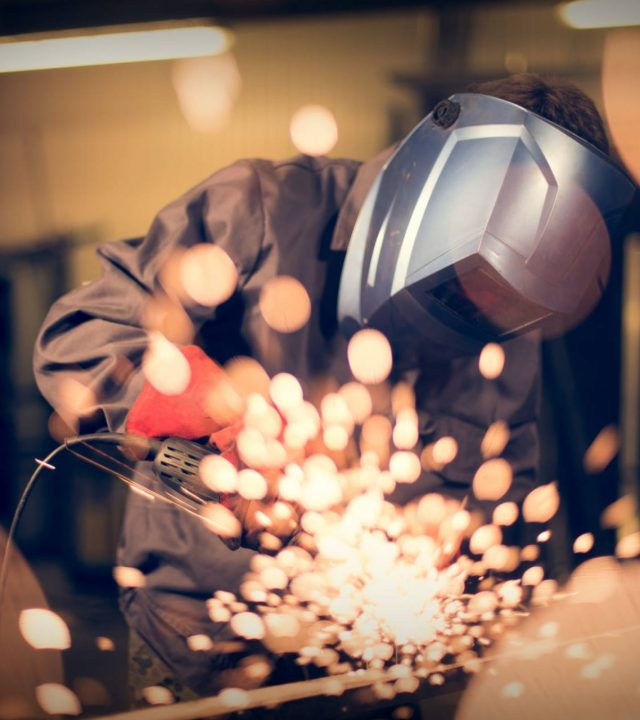 Employee-grinding-steel-with-sparks